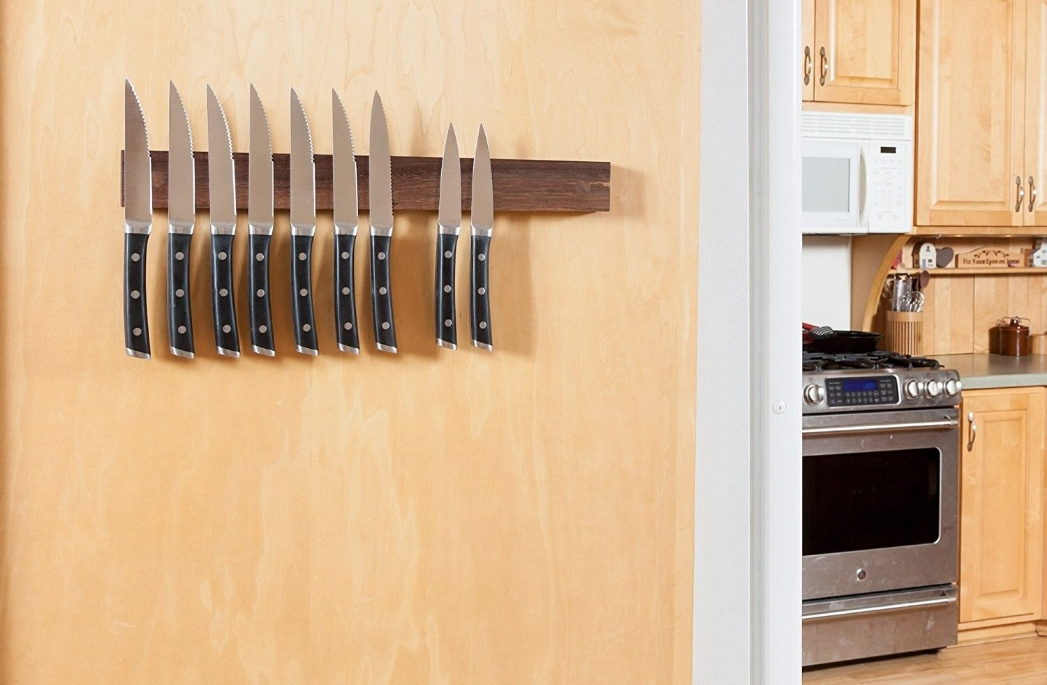 wood magnetic knife mount on a kitchen wall