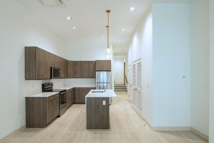 1BD/1BR Rent Range $1,180 – $1,525 - This brand new building features a fitness center, art gallery, clubhouse, and more! Plus, you receive 1-month free rent. Where do I sign?