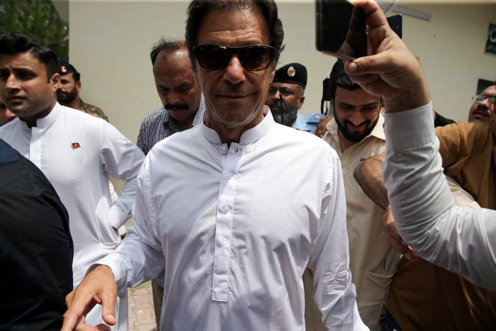Cricket star–turned-politician Imran Khan, chair of the Pakistan Tehreek-e-Insaf (PTI) party, arrives at a polling station during the general election in Islamabad, Pakistan, July 25.