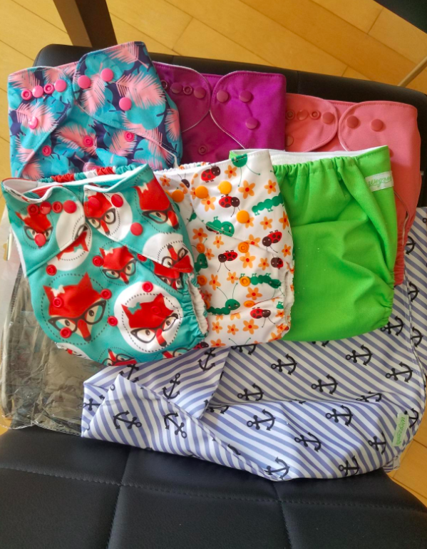 We use cloth diapers — they're adorable and way less expensive than the disposable kind.—larkinhpgIf you're on the fence about the idea, you can read more about how and why people choose to use reusable diapers here. Get six diapers, six liners, and one wet bag from Amazon for $31.99+ (available in six print options).