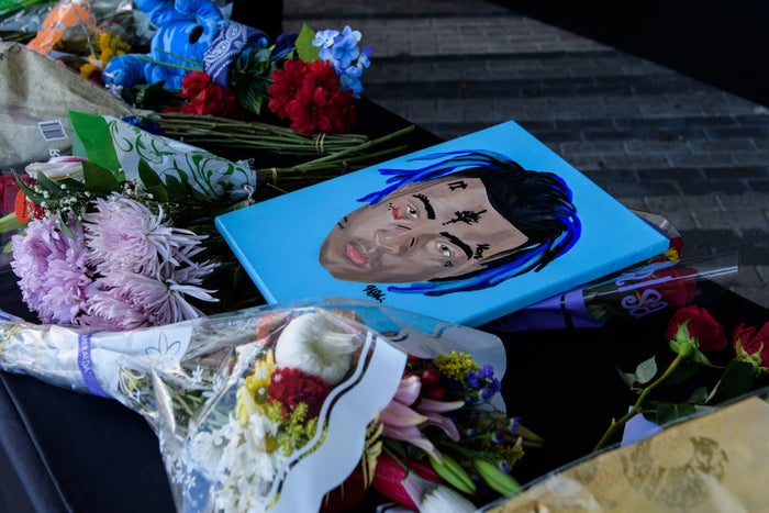 Fans leave items at a makeshift memorial outside the XXXTentacion Funeral & Fan Memorial on June 27, 2018 in Sunrise, Florida.