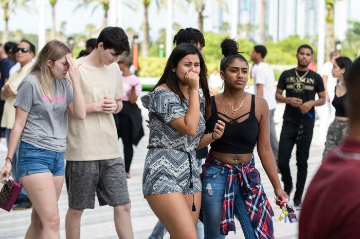 Fans mourn after exiting the XXXTentacion Funeral & Fan Memorial.