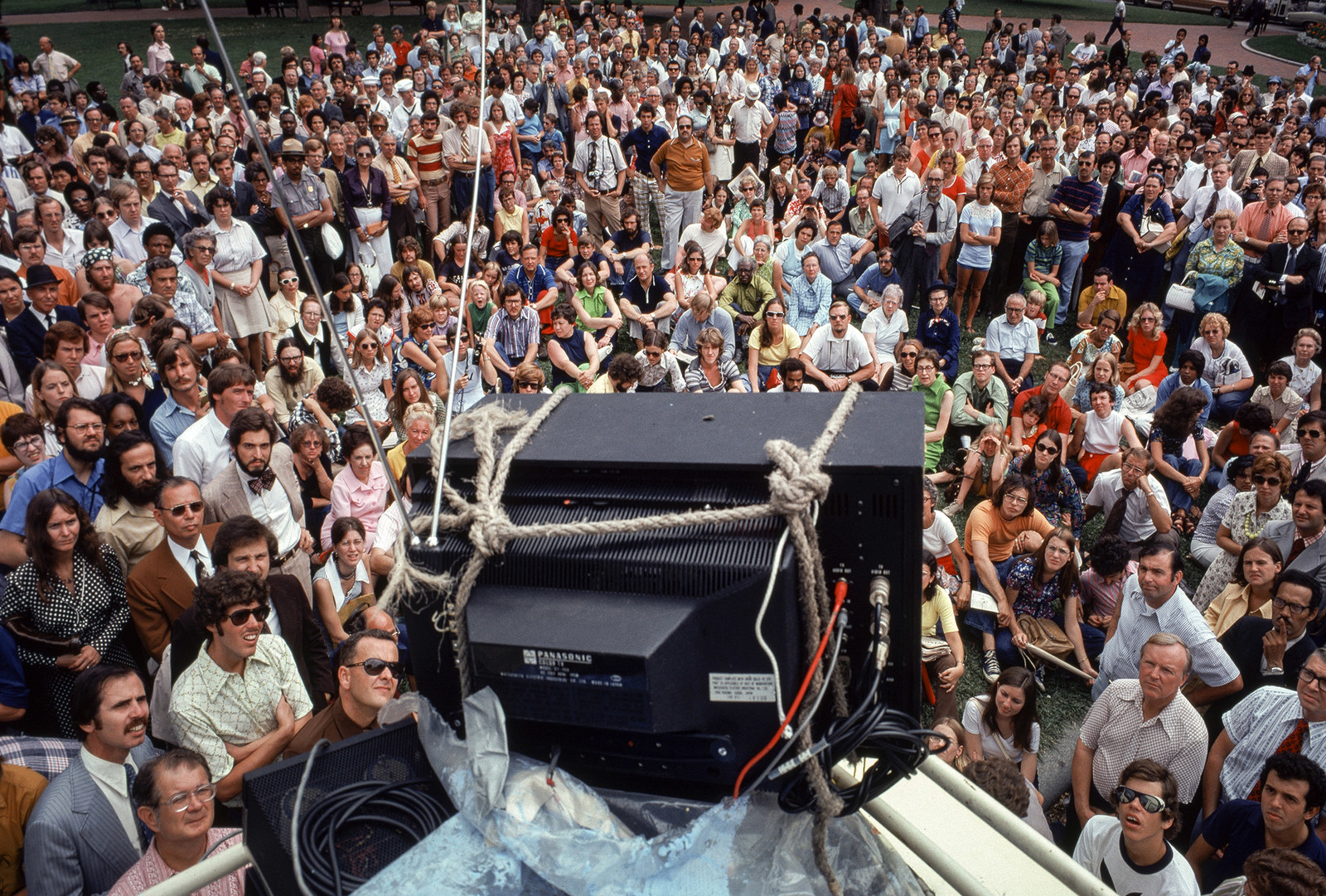 A crowd in front of the White House watches President Nixon's resignation speech.