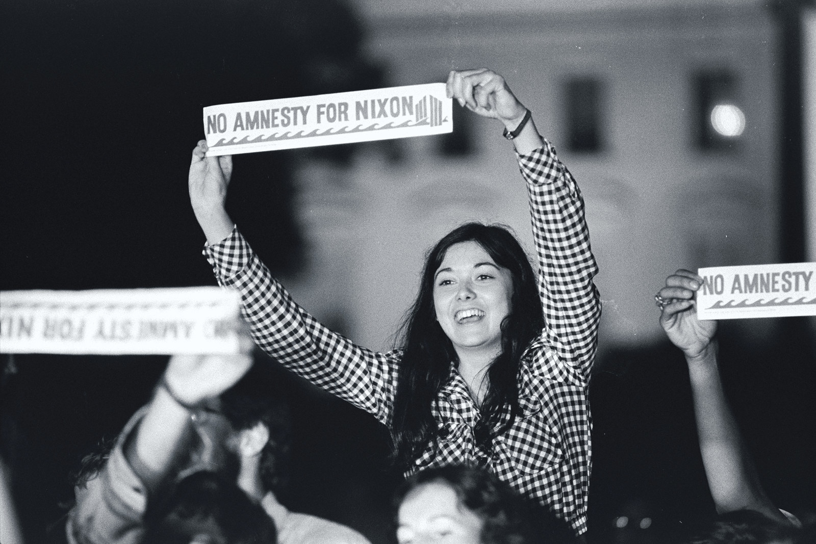 """A demonstrator holds a """"No Amnesty For Nixon"""" sign outside the White House."""