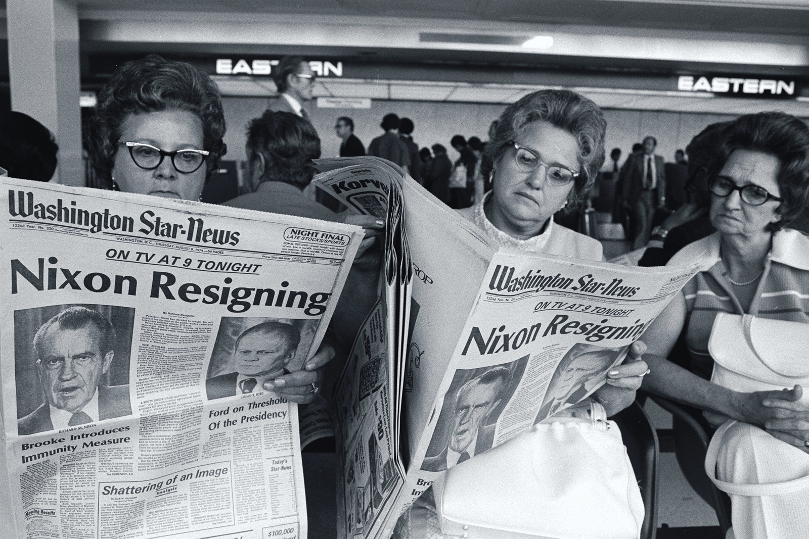 Women at Washington National Airport read copies of the Washington Star-News newspaper.