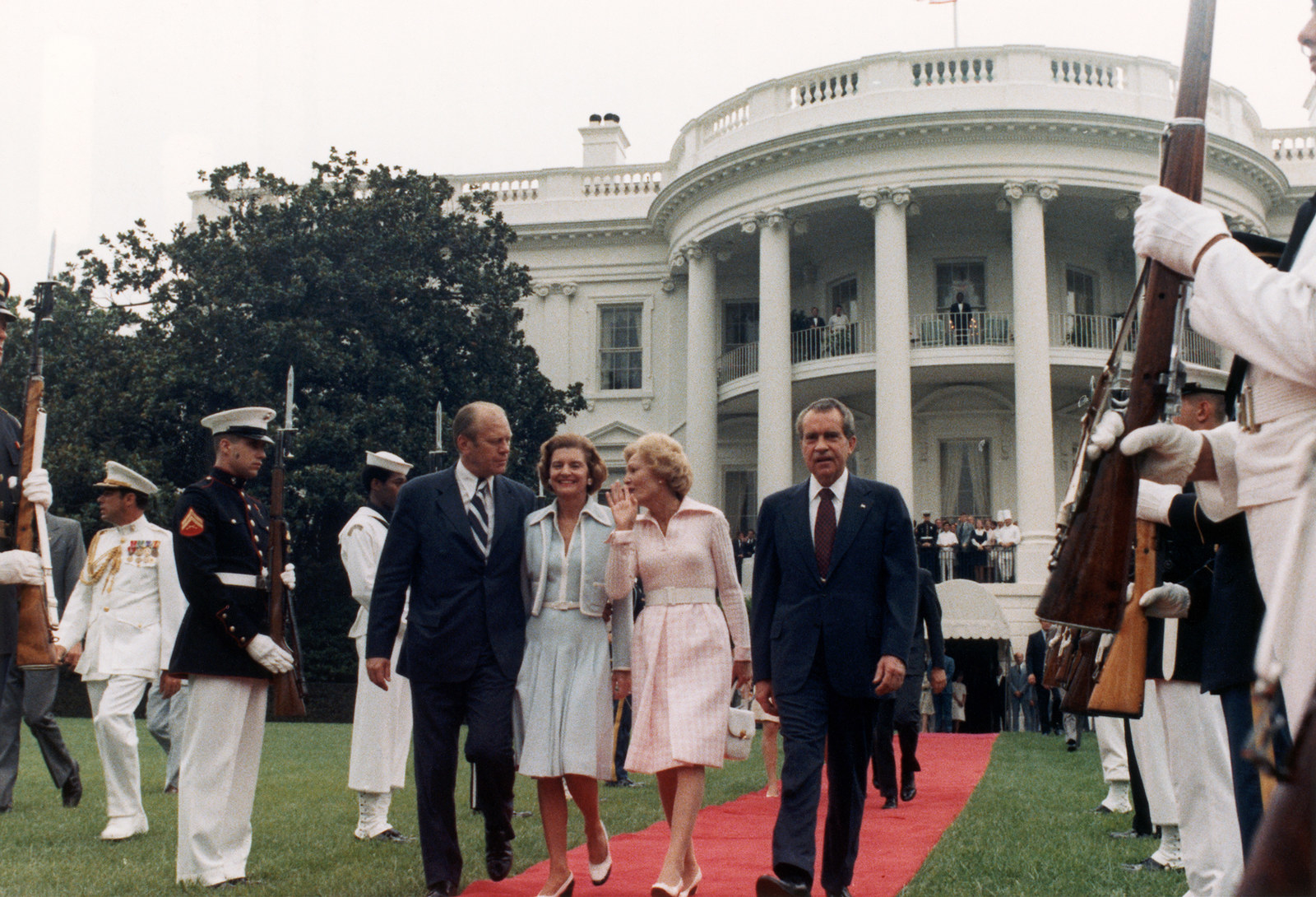 After resigning, President Nixon leaves the White House with (from right) Vice President Gerald Ford, second lady Betty Ford, and first lady Pat Nixon.