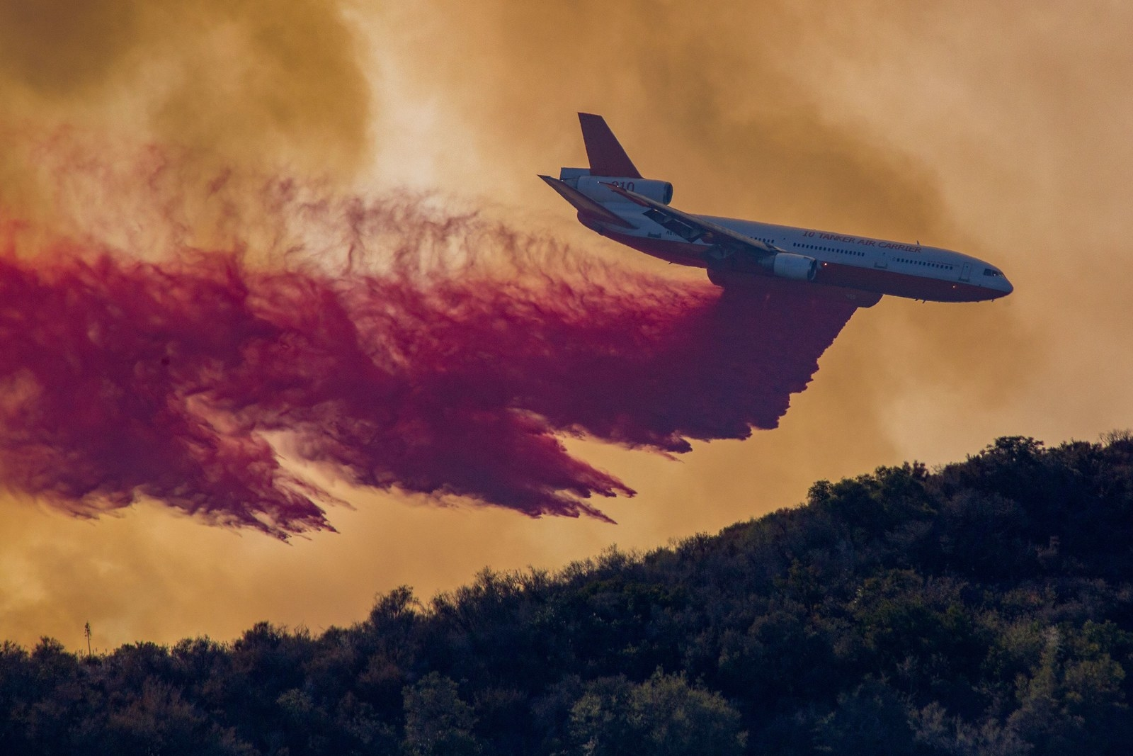 An airplane drops fire retardant at the Holy Fire near Lake Elsinore, California, on Aug. 7, 2018.