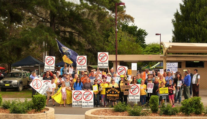 Groundswell Gloucester members rally against the mine in town.