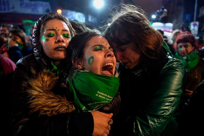 Abortion rights activists comfort one another in Buenos Aires.
