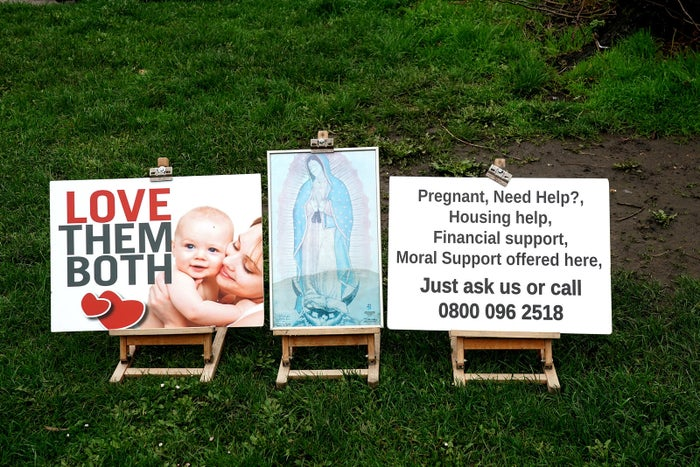 Protest signs outside the Marie Stopes abortion clinic on Mattock Lane, Ealing, London.