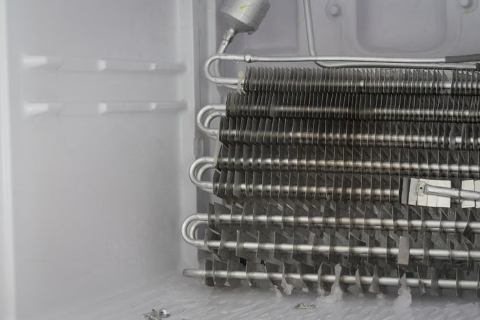 The coils help release heat and keep the fridge cool, so if they're clogged they're going to use more energy and eventually stop working altogether. After unplugging the fridge, move the fridge away from the wall so you can remove the lower back cover. Use a bristle brush to gently pick any debris out of the coils. Then vacuum around the coils, being careful not to push out the blades. If your fridge has a condenser fan, the job is a bit easier, as all you need to do is vacuum around it with the brush attachment. Once you're done, replace the lower back cover and turn your fridge back on. Learn more here.Get a brush that cleans both refrigerator coils and dryer vents from Amazon for $11.64.