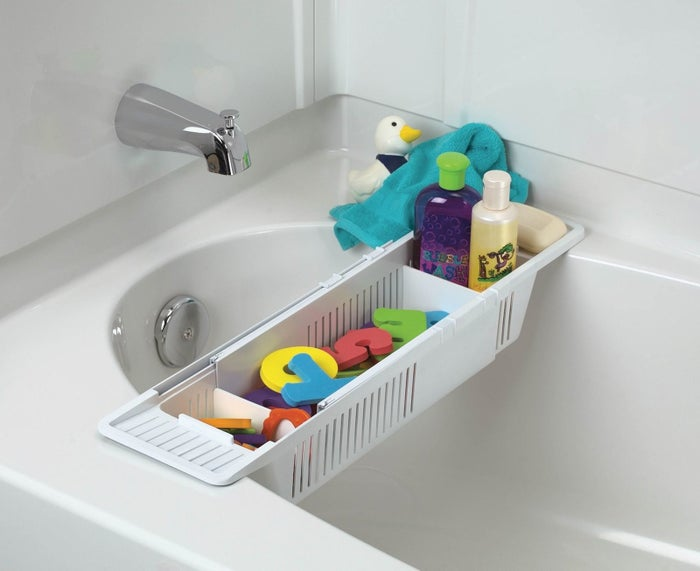 "Promising review: ""I love this! I initially got it with the intention of using it for my own bath products, but I ended up putting it in the baby's bathroom and using it to store toys. It allows water to drain out from the toys and dry out easily. I love the adjustable nature of the product to fit any size tub. My child does like to stand up and lean on it, and it seems pretty sturdy. Overall, this is a great product, and I highly recommend it."" —steel_muffinsGet it from Amazon for $9.99."