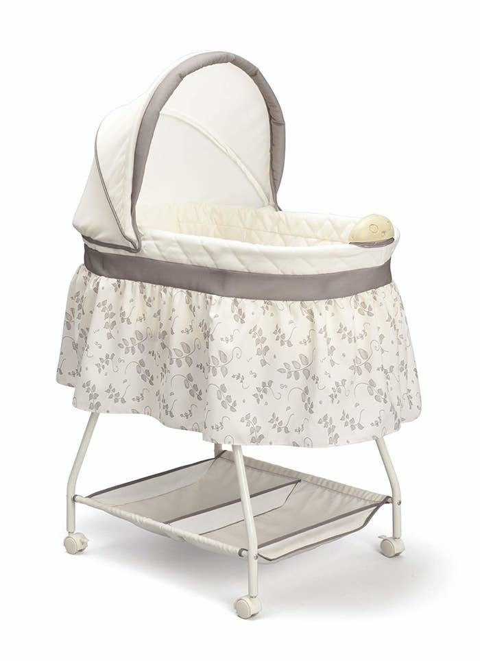 """Promising review: """"My daughter loves this bassinet. She's a month old, and we sleep with it next to our bed. The nightlight is great for late-night diaper changes and the music is nice. It took me 30 minutes to put it together, and the fabric is easy to remove and clean."""" —Alison Price: $47.19"""