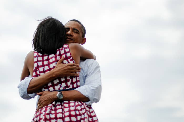 First lady Michelle Obama and President Barack Obama hug after delivering remarks during a campaign event in Dubuque, Iowa, on Aug. 15, 2012.