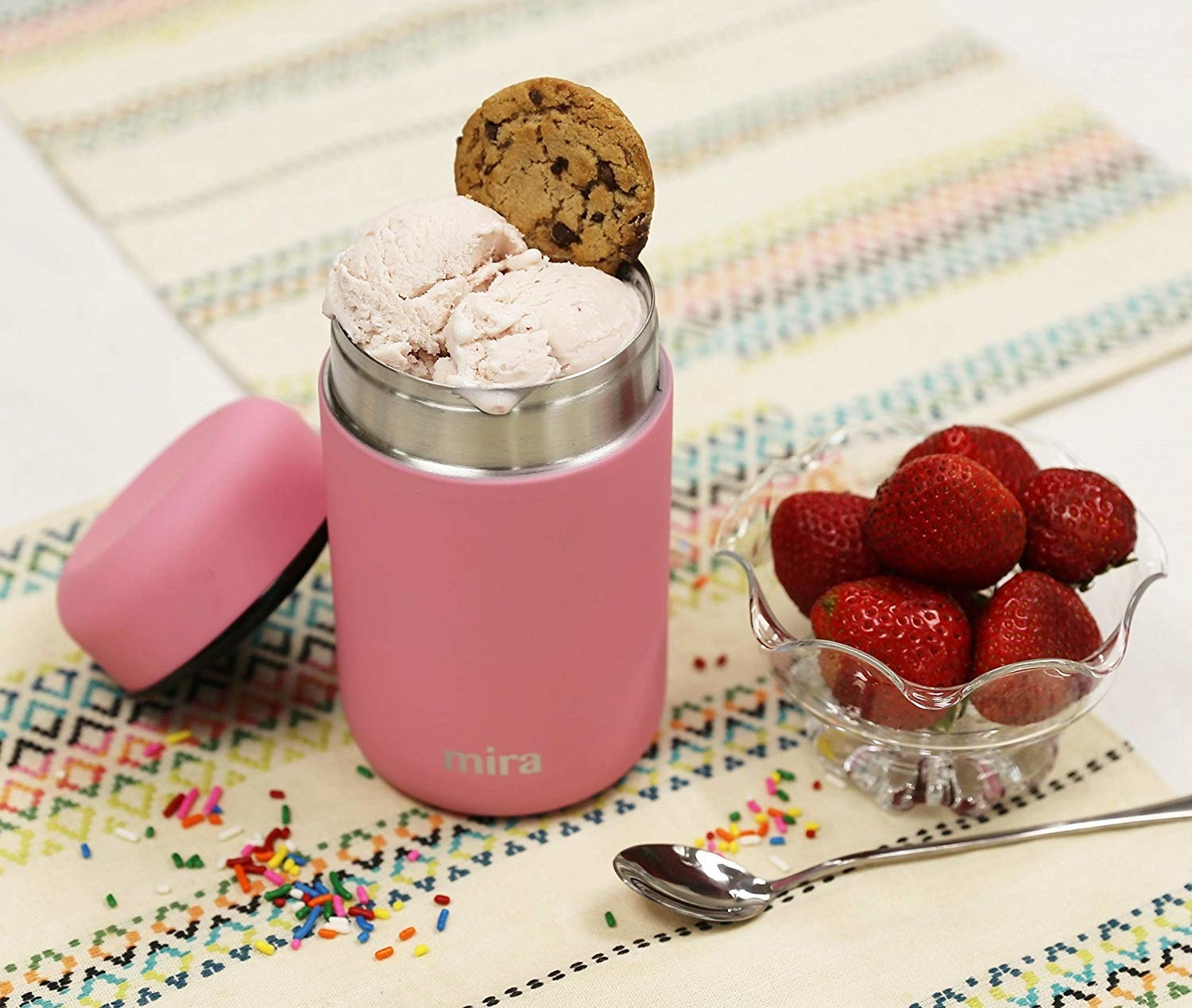 the pink thermos with strawberry ice cream in it