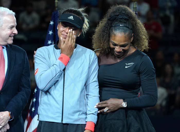 Champion Naomi Osaka of Japan (left) with Serena Williams of the US during their Women's Singles Finals match at the 2018 US Open.