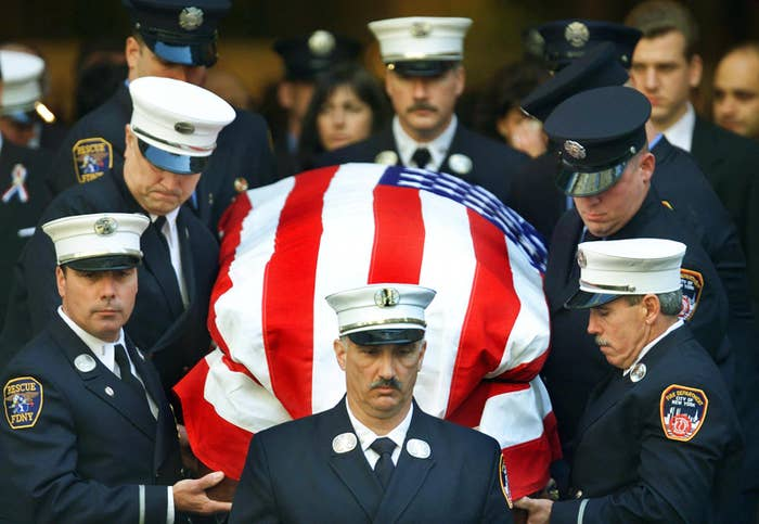 New York City firefighters carry the casket of Capt. Terence Hatton at St. Patrick's Cathedral in New York City on Oct. 4, 2001.