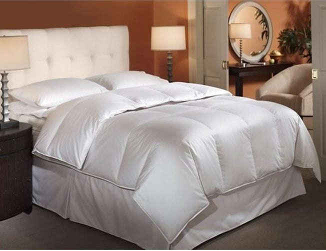 """""""A heat-retaining comforter that slid into my duvet kept me nice and toasty in my old drafty apartment."""" —elizabethlillyAccording to reviewers, this mid-weight down-alternative comforter has everything you need to keep cozy and warm this winter: 100% cotton fabric, well-sewn seams that keep the filling from bunching up all in one corner, and tie-down loops to hold it in place in your duvet cover. Get a queen size on Wayfair for $88.99 (also available in twin and king, all under $100)."""