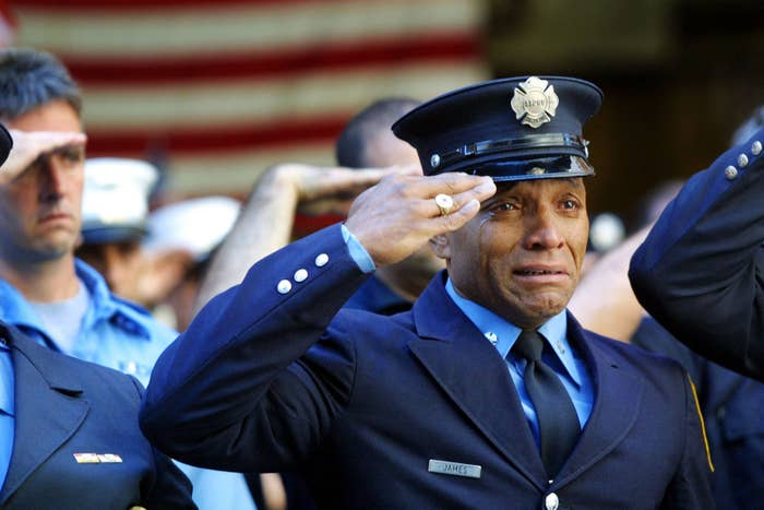 Firefighter Tony James cries while attending the funeral service for FDNY chaplain Mychal Judge on Sept. 15, 2001, in New York City.