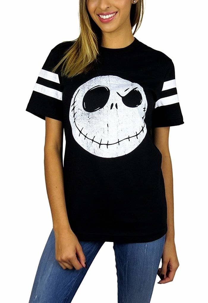 """🎶 THIS IS HALLOWEEN THIS IS HALLOWEEN 🎶Promising review: """"This is the best shirt ever! Good quality, fits perfectly, and I love the design!"""" —Daniela Moore Get it from Amazon for $23.99 (available in sizes S-XL)."""