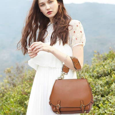 34b80d1e483 14. A stylish saddle bag with an embellished handle and removable shoulder  strap that effortlessly combines fashion and function.