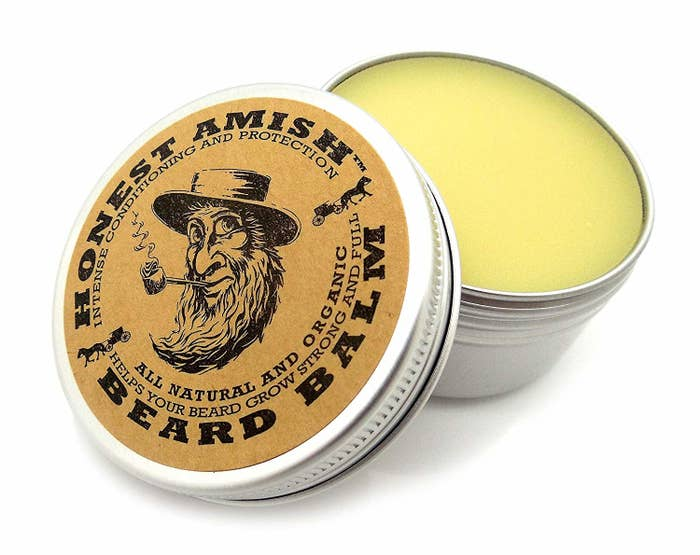 If you haven't heard of Honest Amish Beard Balm, it's basically a leave-in conditioner for your facial hair that's made with all-natural and organic vegan ingredients —including argan, avocado, almond, pumpkin seed, and apricot kernel oils, fruit and nut butters, and hair-enhancing essential oils — and smells a bit like black licorice. Yum.