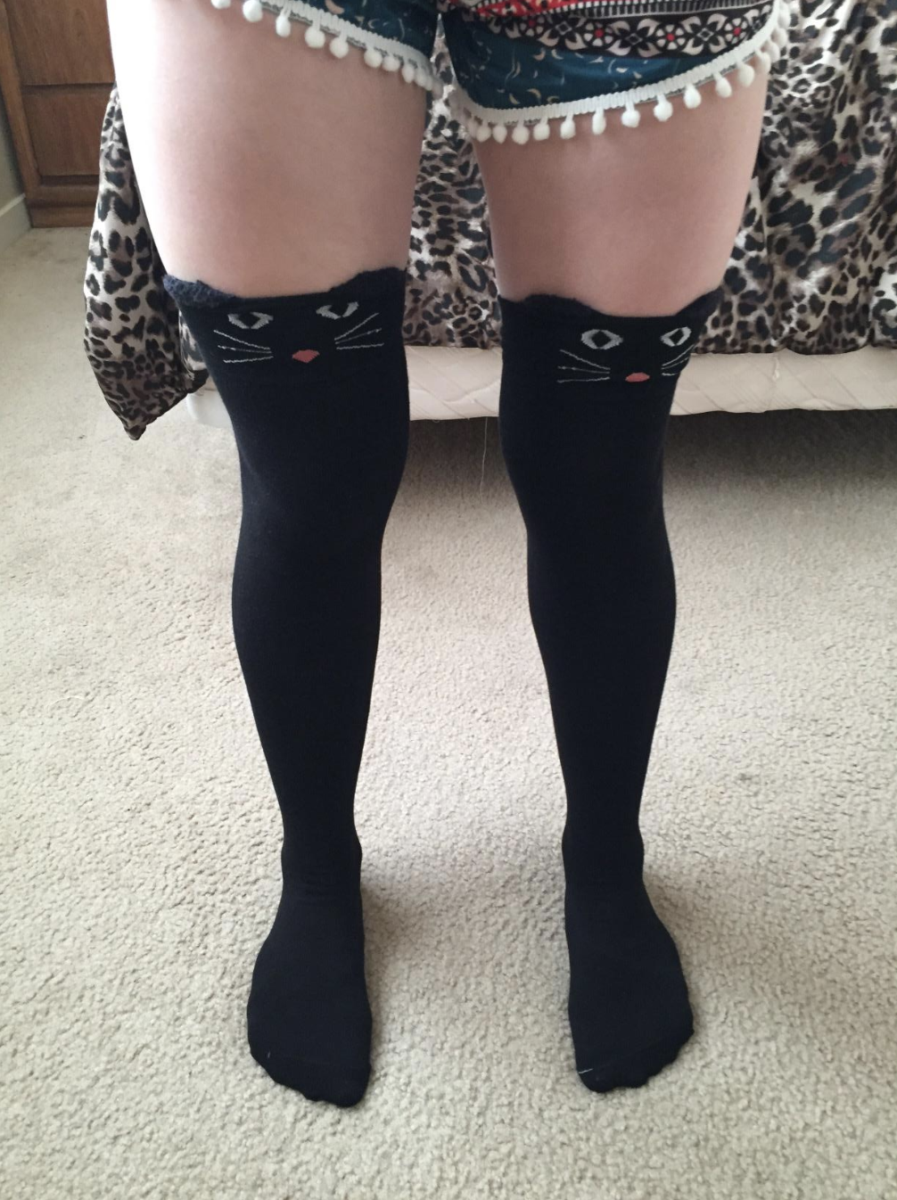 7b821ec13 A pair of knee-high animal socks that increases the risk of your leg being  mistaken as your precious pet wearing a sandal.