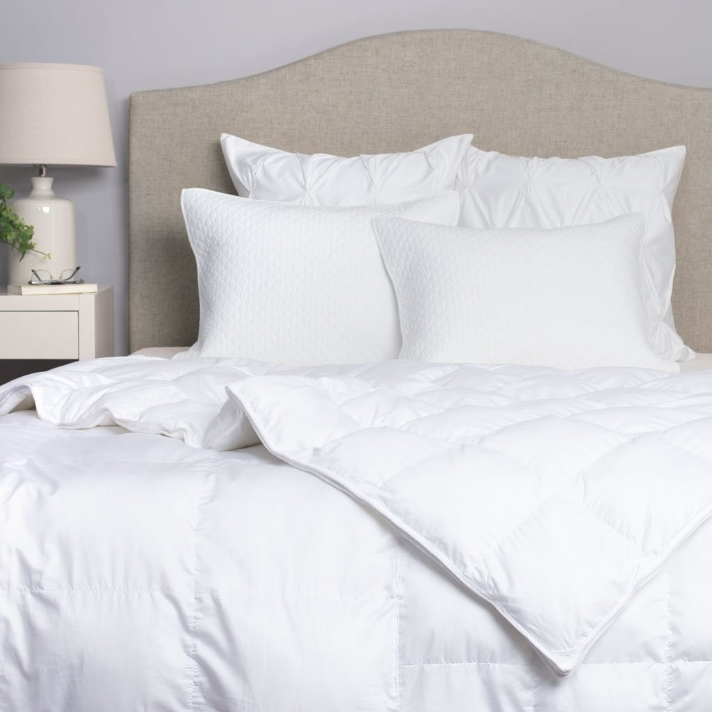 the white comforter on a bed