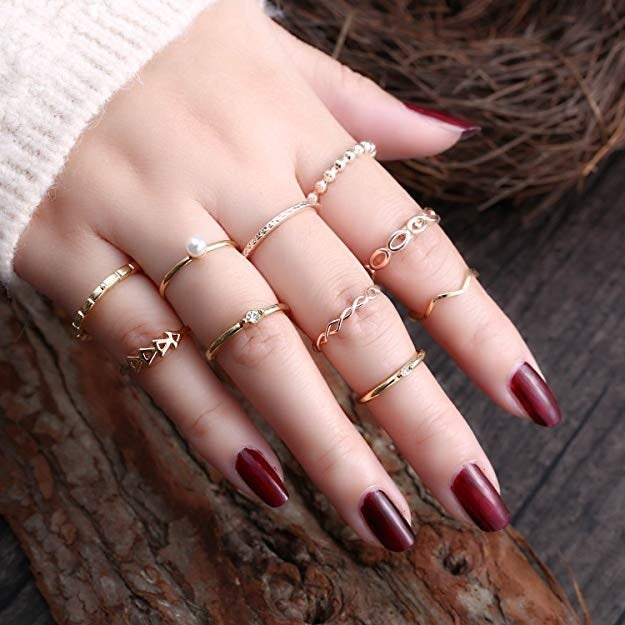 """Promising review: """"I'm really impressed with this set of rings, especially at this price point. I ordered the 'gold' set, which is a mix of a yellow gold and rose gold rings. The coloring mimics real gold, and everything arrived in great condition. I did apply a coat of topcoat to the things to prevent any discoloration as I plan to wear them regularly."""" —TiffanyGet them from Amazon for $7.79+ (available in seven style sets)."""