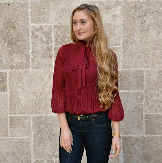 0b12baed67ce2 A pleated chiffon blouse with a tie-neck collar so you can dress to impress  at work