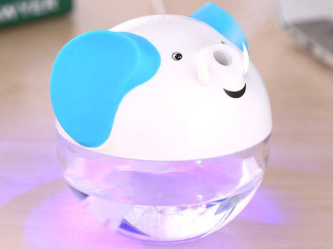 The humidifier is USB-powered and has an auto-shutoff safety sensor. Get it from Amazon for $8.99+ (available in white, green, and pink).