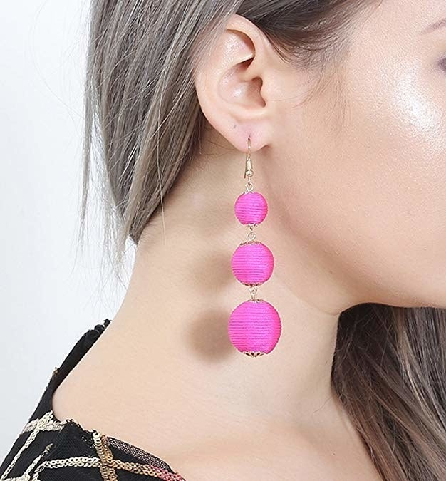 """Promising review: """"Super cute!!! Very pretty and vibrant in person. High quality, no loose threads of anything like that. I saw these at a chain store but refused to pay $15/set for earrings. They look exactly like the ones I saw in store."""" —TX_BobcatsGet them from Amazon for $7.99+ (available in 24 style and color combinations)."""