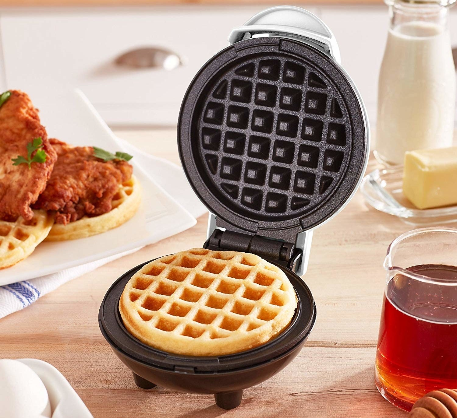 """This weighs just over 1 lb., heats up in minutes, and has a non-stick surface for even cooking. Promising review: """"This little waffle maker is so perfect! It makes the perfect-sized waffles, the smaller ones you would get out of the freezer section at the grocery store. I just buy some mix and make a huge batch to freeze for my son, and he just pops them in the toaster. I also made a bunch to make waffle sandwiches for my daughter. Healthier and a lot cheaper. I make those and freeze them as well so I can just pop them in the microwave."""" —SnoopyHJGet it from Amazon for $9.99 (originally $14.99, available in seven colors)."""