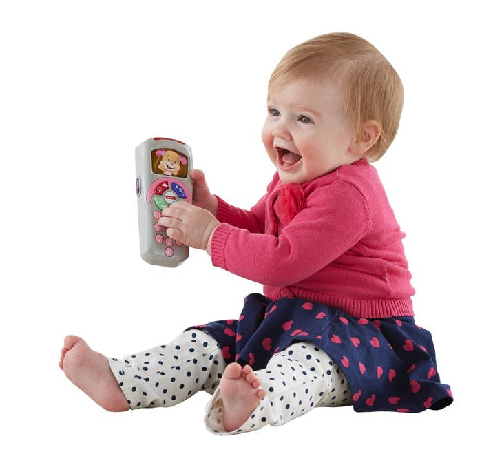 """Promising review: """"My 8-month-old daughter loves the music and sounds this toy makes. She constantly took the TV remote and changed the channels and tried to put it in her mouth, so finding this was perfect. It's pretty durable considering she drops it out of the shopping cart several times before purchasing it, and it still works perfectly. The price is great for a family on a tight budget."""" —simply_HarmonyGet it from Walmart for $7.88."""
