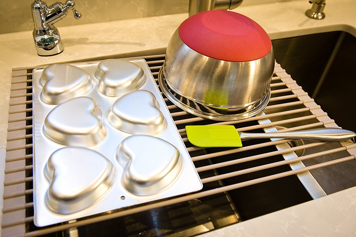 A pot and pan drying on the rack