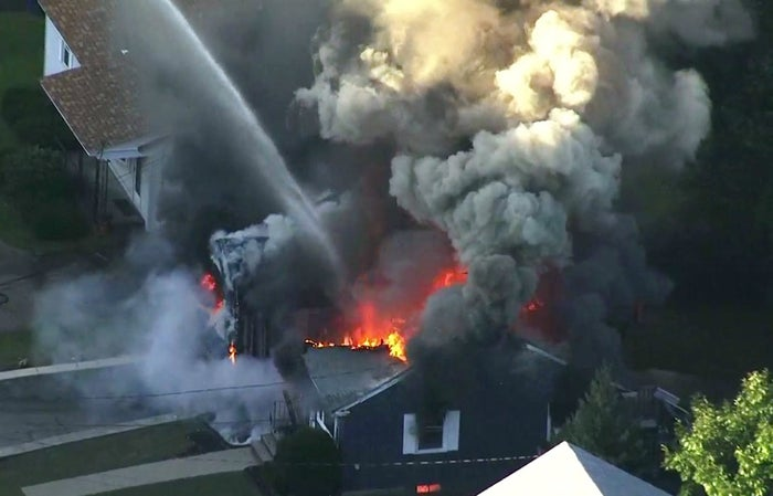 Flames consume a home in Lawrence, Mass.