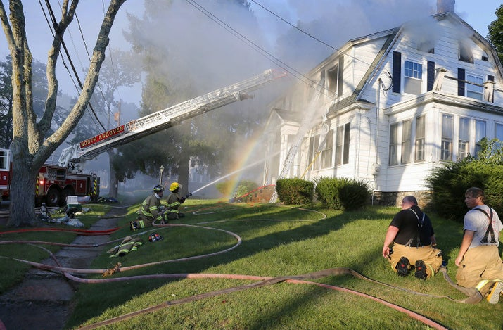 Firefighters battle a house fire Thursday in North Andover.