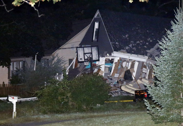 A house is destroyed in Thursday in Lawrence.