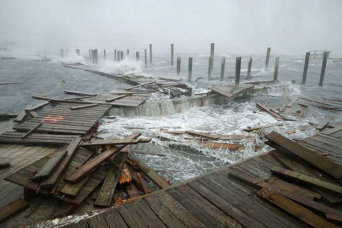 Portions of a boat dock and boardwalk are destroyed by powerful wind and waves as Hurricane Florence arrives on Sept. 13, in Atlantic Beach, North Carolina.