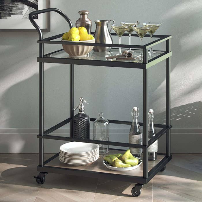 A Ious Bar Cart With Enough Room For 10 Bottles On The Bottom And Locking Wheels To Keep Things Steady