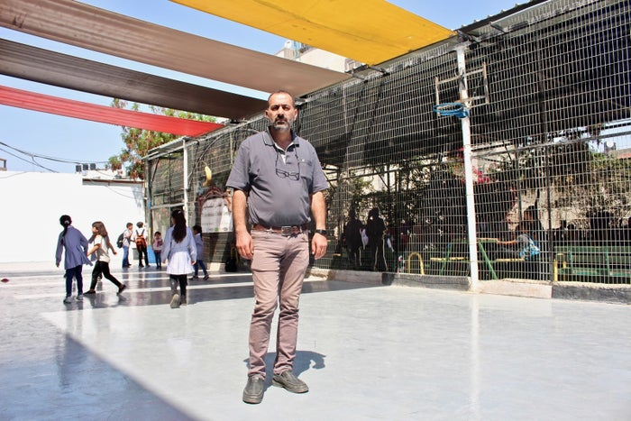 Khaled al-Sheikh Ali working at the Shuafat camp's Palestinian Child Center.