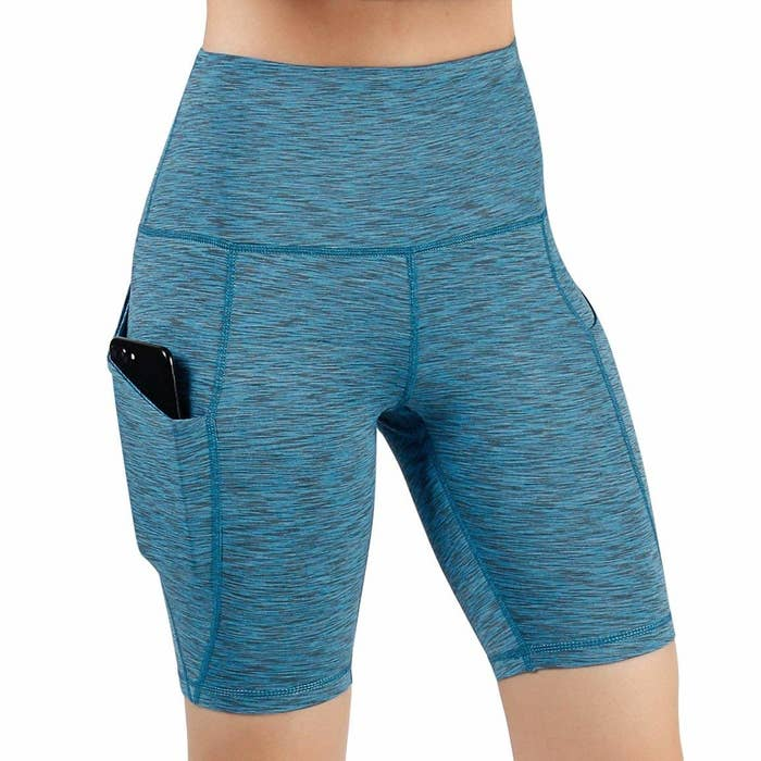 24dd7b3e9 High-waisted shorts with a pocket to comfortably stash your phone so you  can crank your favorite tunes to get your bod moving and grooving.