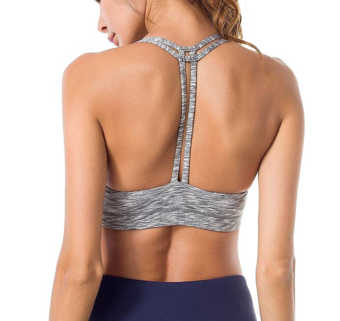 56108838f A T-backed sports bra with double straps to keep everything up there  supported and stylish.