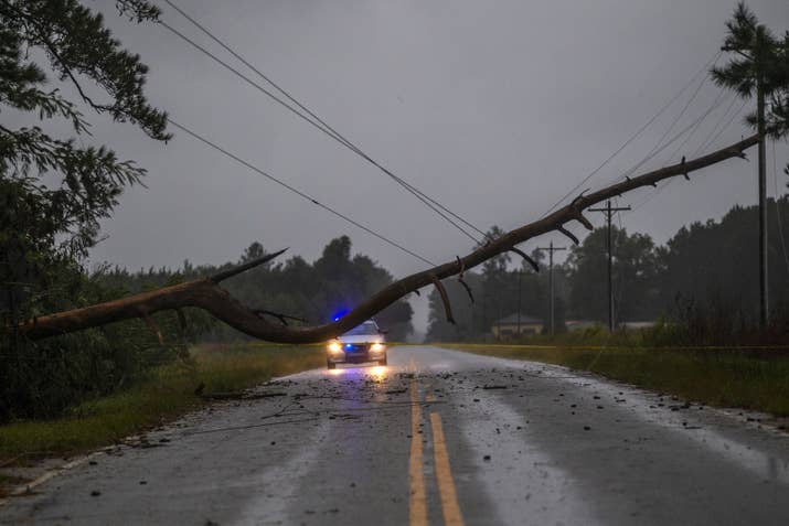 "A woman was killed after her vehicle hit a tree downed by Florence on Friday evening, the first storm-related death in South Carolina and the sixth overall.The 61-year-old female from Union, South Carolina, was driving on Highway 18 around 9:40 p.m. on Friday when the roof of her car struck a tree that had partially-fallen across the road, Captain Kelley Hughes of the South Carolina Highway Patrol, told BuzzFeed News.""She died at the scene. She was the only occupant in the vehicle and she was wearing a seatbelt,"" explained Hughes.—Amber Jamieson"