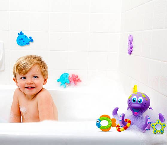 """Promising review: """"This is a great bath and pool toy. My wife and I got this for our daughter when she was 10-months-old. It's four months later and she still loves it. She enjoys taking the rings on and off, and she also enjoys playing with the rings alone. She'll often bring some of the rings with her after bathing and play with them as we dry and dress her. We really liked that there were no openings on the octopus, so that no water could get in and potentially cause molding. This is one of our daughter's favorite toys, and I'm sure she'll enjoy it for a long time to come."""" —Mach V. ManuelPrice: $6.85"""