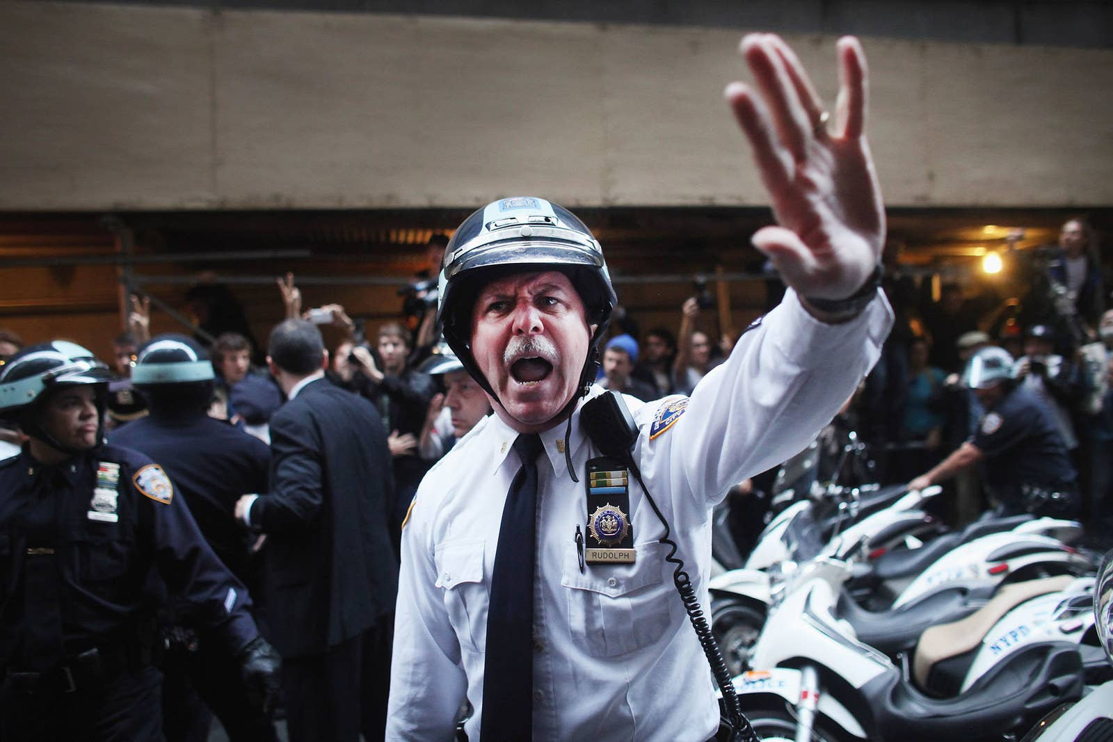 Police scuffle with protesters marching through the streets of the Financial District on Oct. 14, 2011, after the deadline for the protesters' removal from a park was postponed.