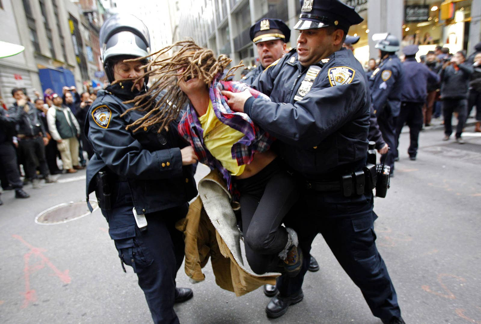 An Occupy Wall Street demonstrator is arrested by New York City police officers on Nov. 17, 2011.