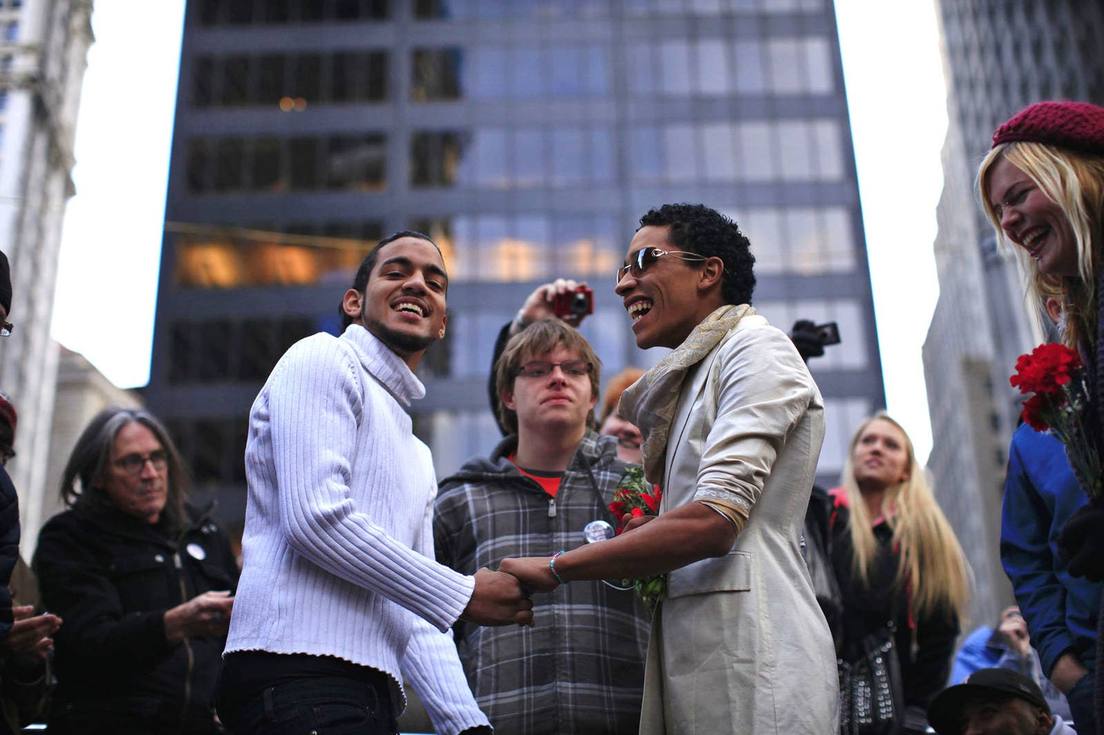 Joseph Allen (center) officiates as fellow protesters Jonathan Lopez (left) and Ivan Cabrera (right) exchange vows during their wedding ceremony at Zuccotti Park on Nov. 19, 2011.