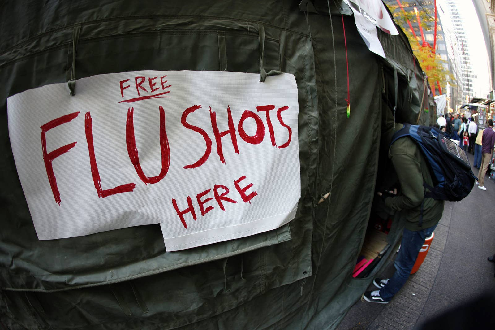 A protester leans into the medical tent where free flu shots and other medical services are being provided at Zuccotti Park on Nov. 10, 2011.