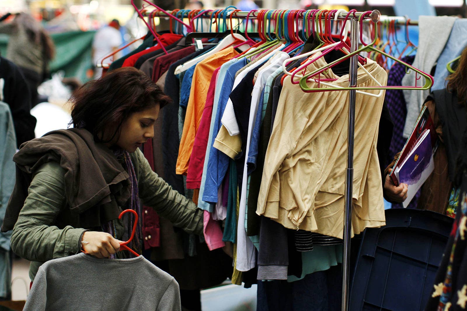 A member of the Occupy Wall Street movement picks up clean clothes from a rack of free, donated clothes at Zuccotti Park on Oct. 22, 2011.